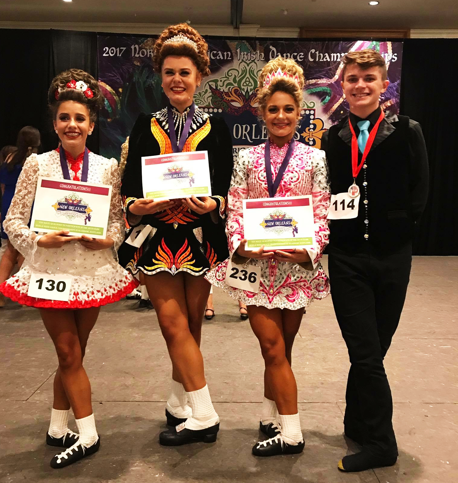 Four competitors in solo costumes.